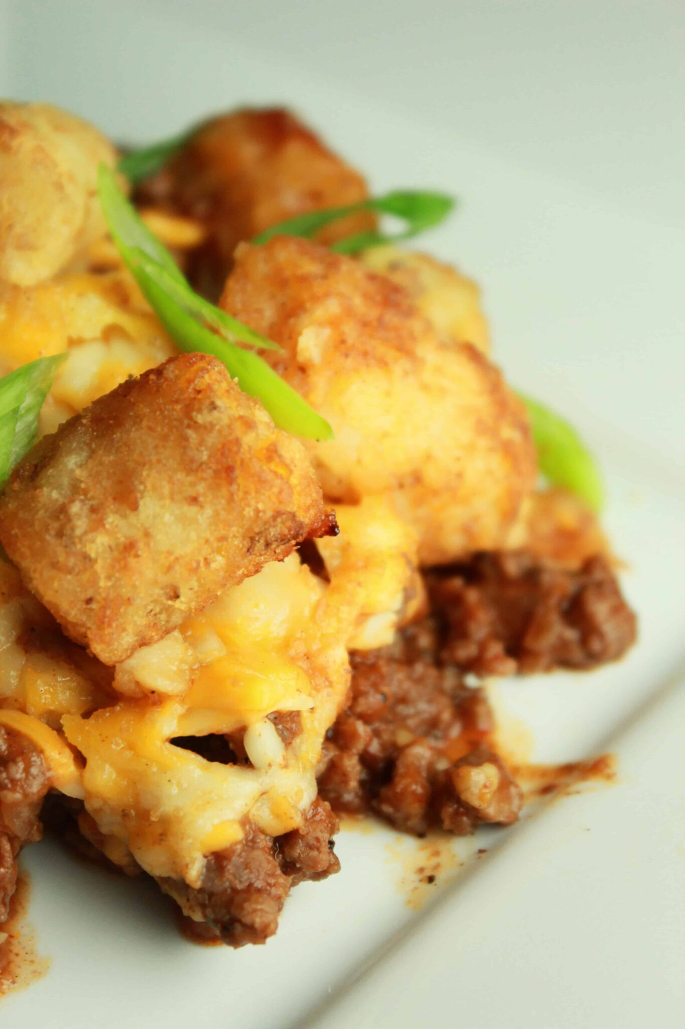 Quick and Easy Family Dinners featured by top US food blog, Practically Homemade: sloppy joe tater tot casserole