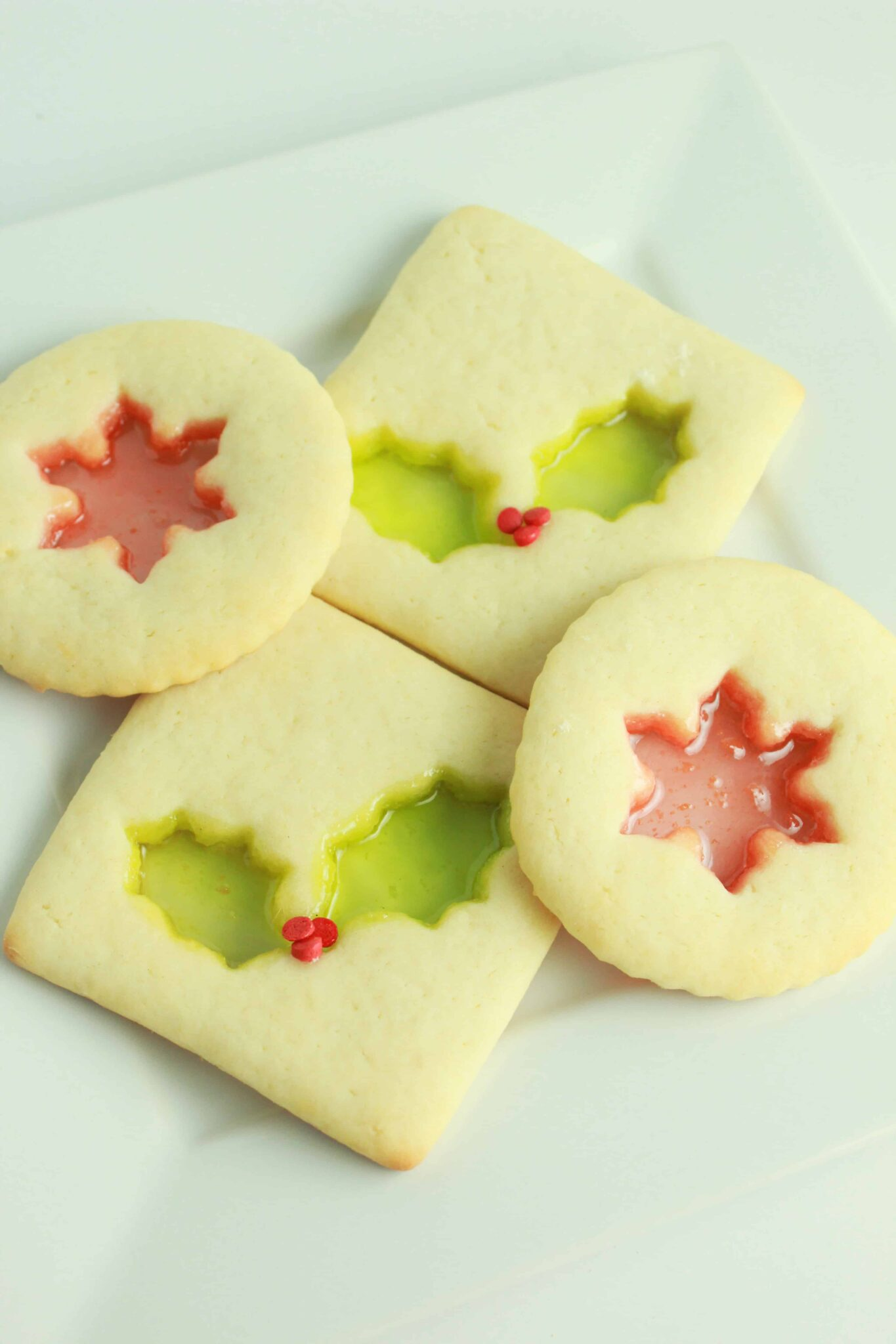 Easy and Delicious Christmas Cookies Recipes for the Holidays featured by top US cookie blog, Practically Homemade: stained glass cream cheese sugar cookies