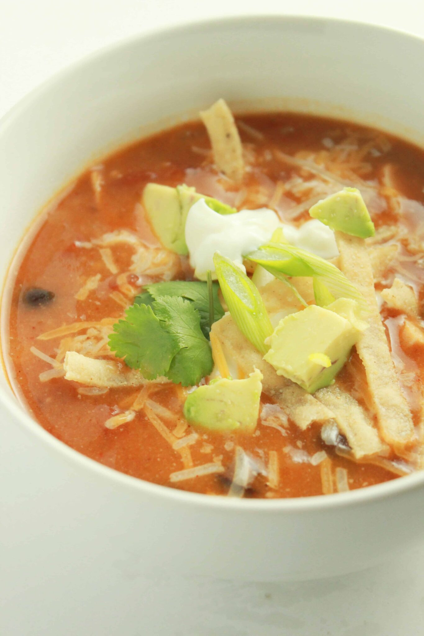 10 Back to School Dinner Ideas in 30 Minutes or Less featured by top US food blogger, Practically Homemade: chicken enchilada soup