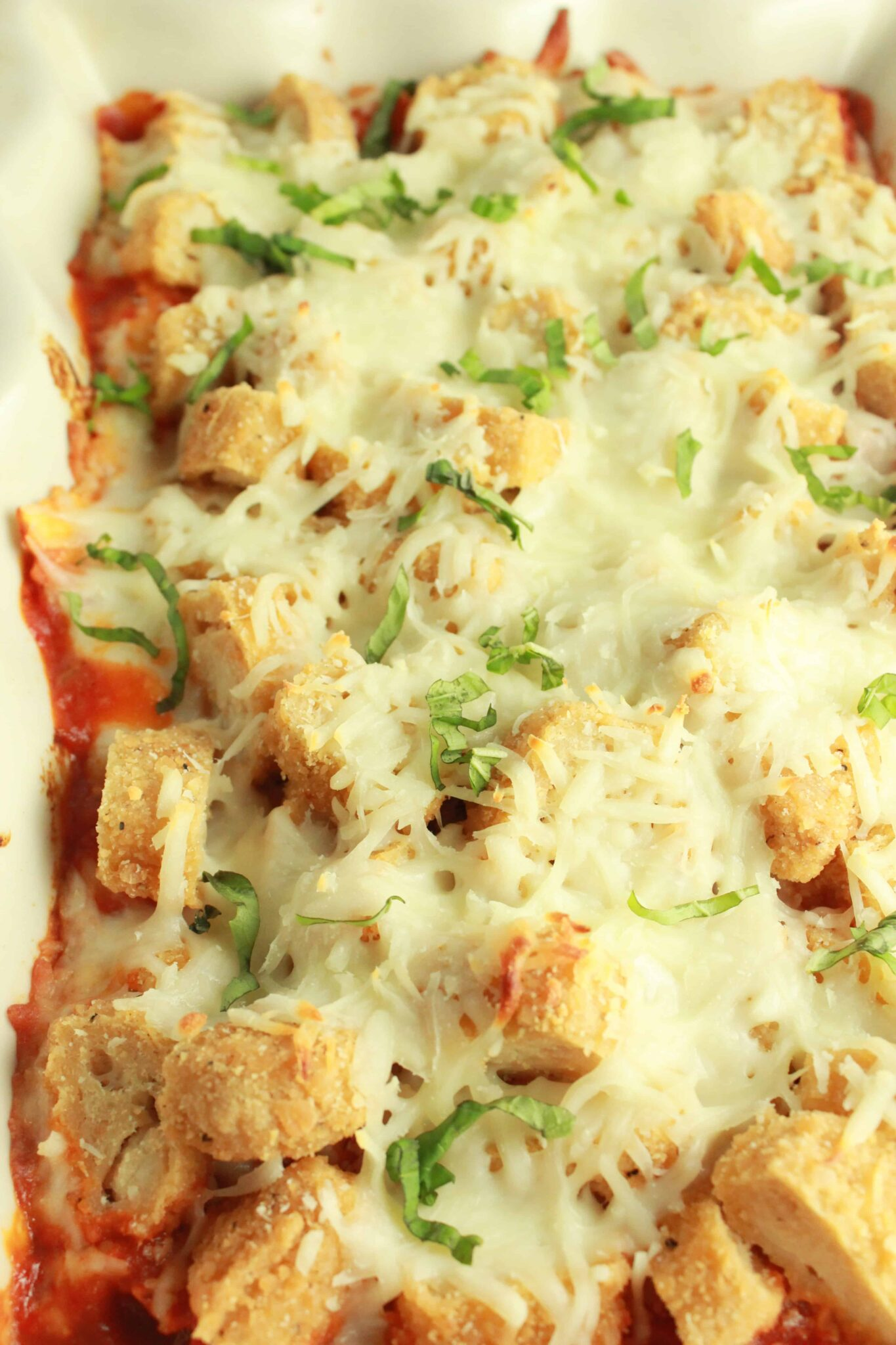 Quick and Easy Family Dinners featured by top US food blog, Practically Homemade: Chicken parm ravioli bake