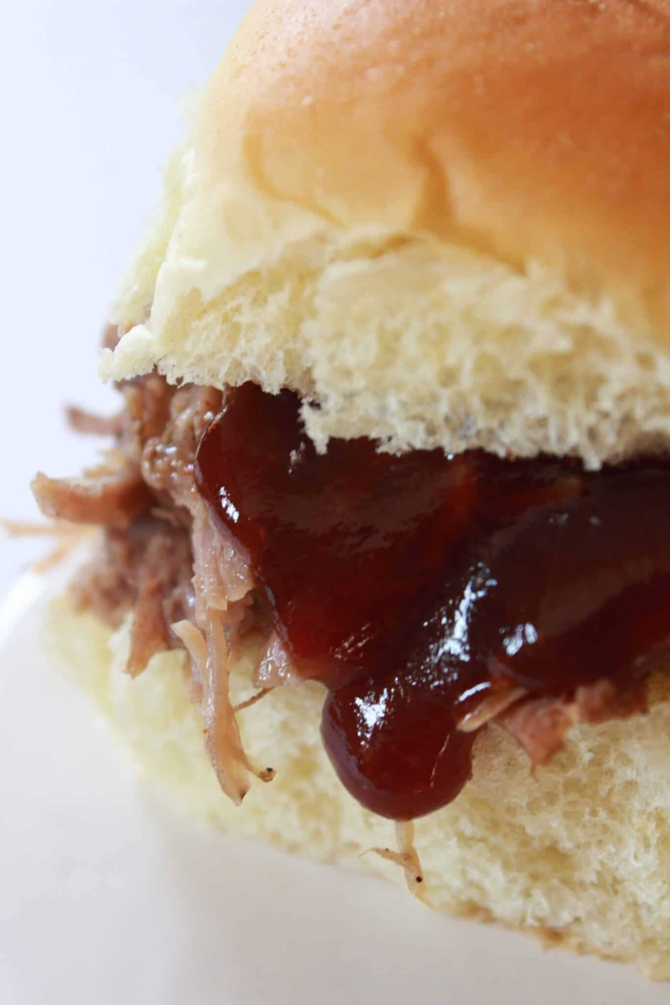 Crock Pot Pulled Pork Recipe featured by top US food blog, Practically Homemade