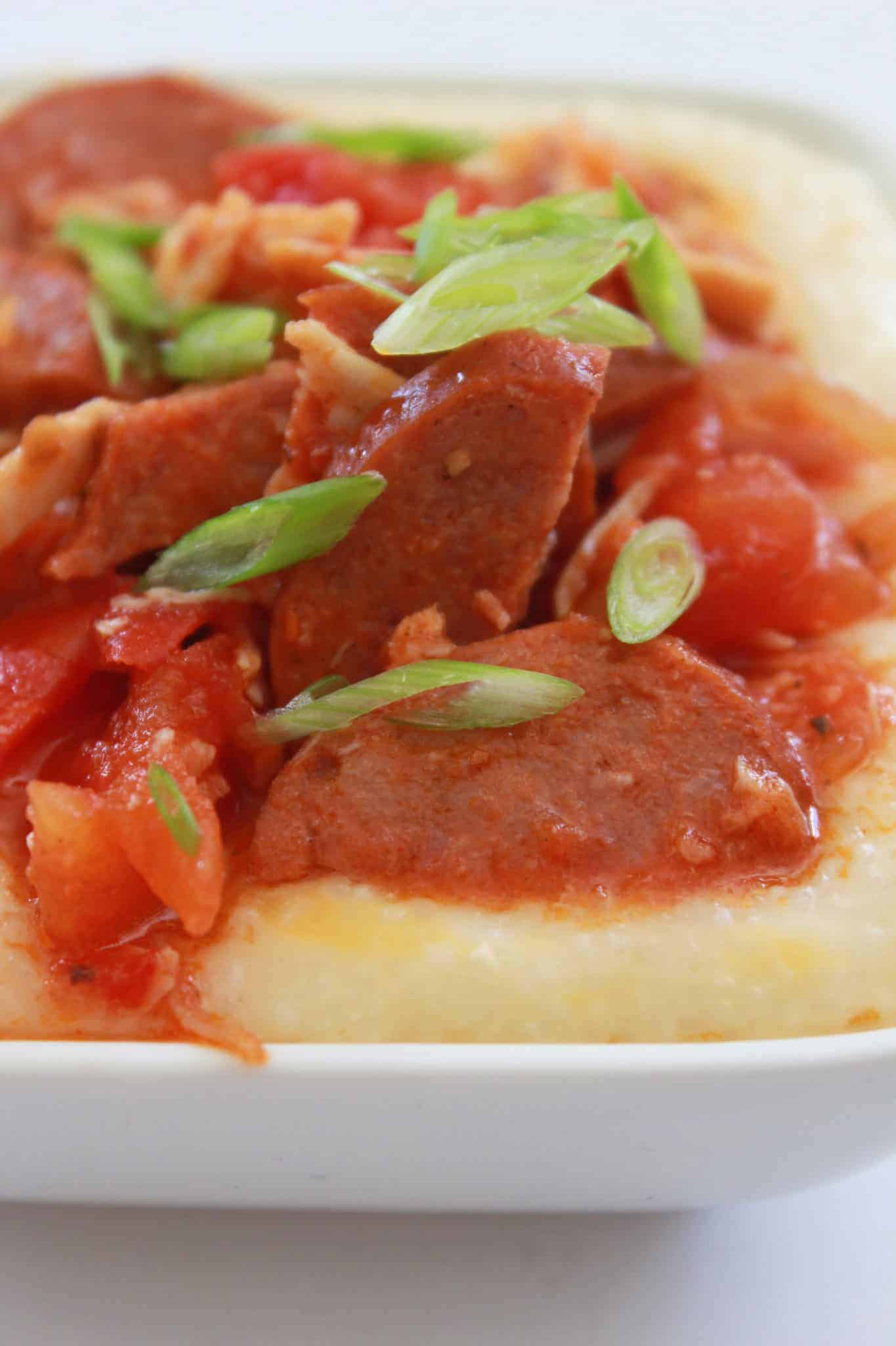 15 Minute Andouille Sausage and Grits Recipe featured by top US food blog, Practically Homemade