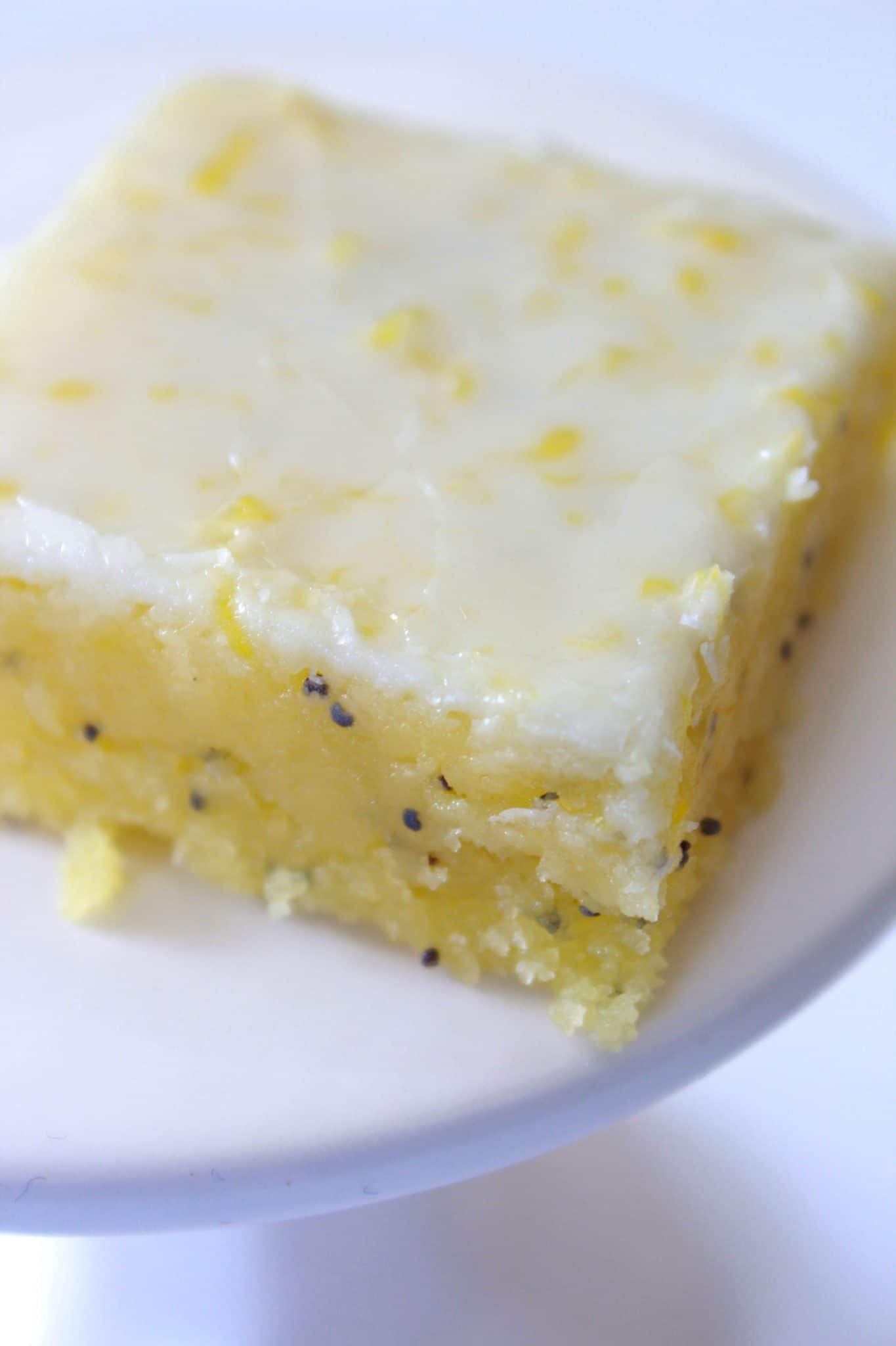 Glazed Lemon Poppy Seed Bars Recipe featured by top US food blog, Practically Homemade