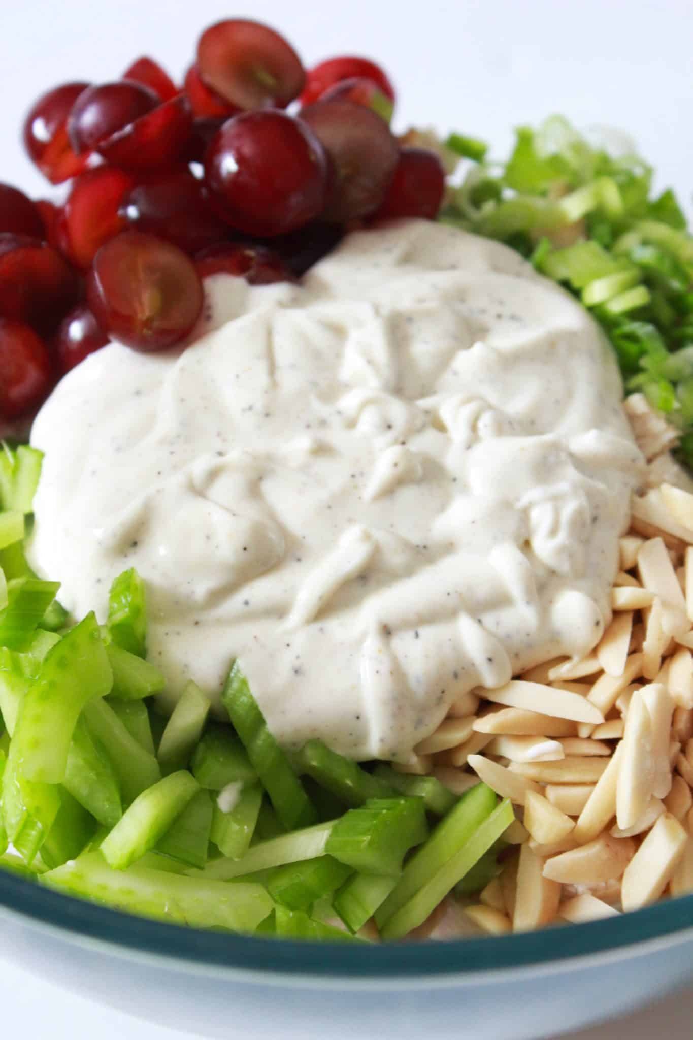 A Quick Summer Chicken Salad with Grapes and Almonds recipe featured by top US food blog, Practically Homemade