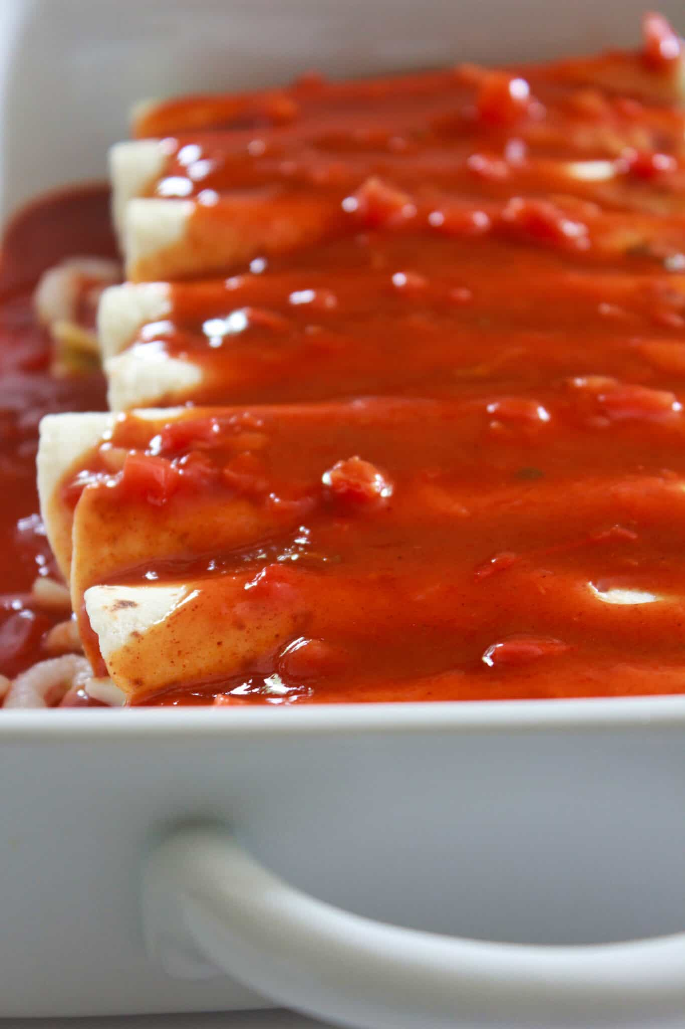 Quick & Easy Shrimp Enchiladas Recipe featured by top US food blog, Practically Homemade