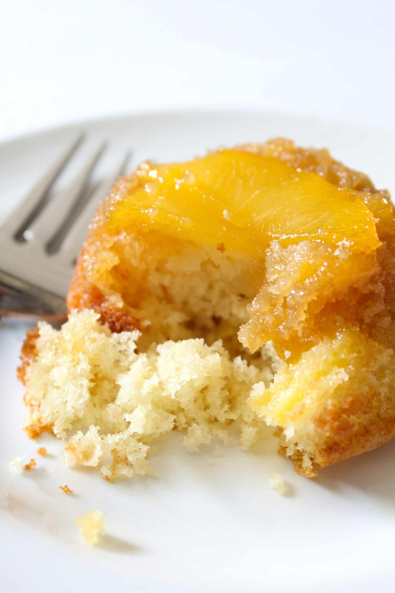 Easy Upside Down Peach Cupcakes featured by top US food blog, Practically Homemade