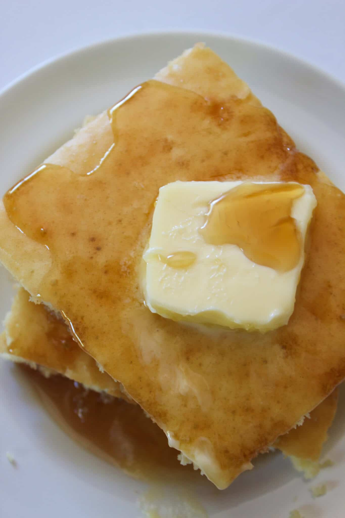 Quick Breakfast Idea: Fluffy Sheet Pan Pancakes from Mix featured by top US food blog, Practically Homemade