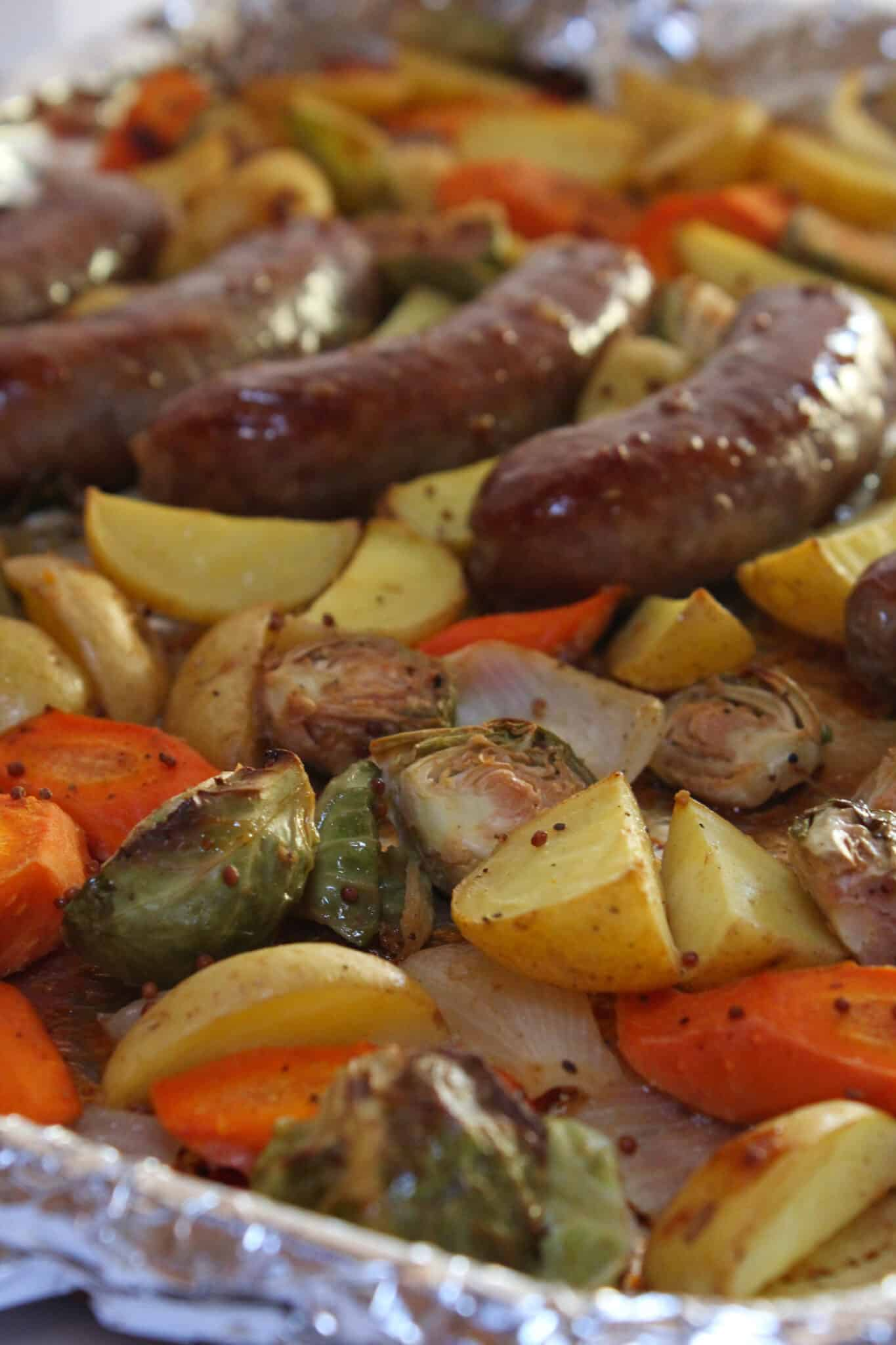 Sheet Pan Brats and Potatoes recipe for Oktoberfest dinner, featured by top US food blog, Practically Homemade