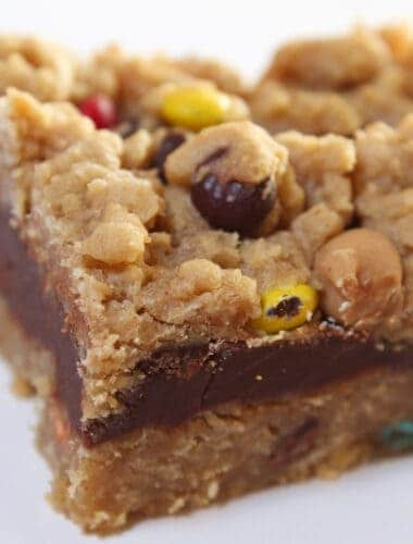 Monster Cookie Oatmeal Fudge Bars Recipe featured by top US food blog, Practically Homemade