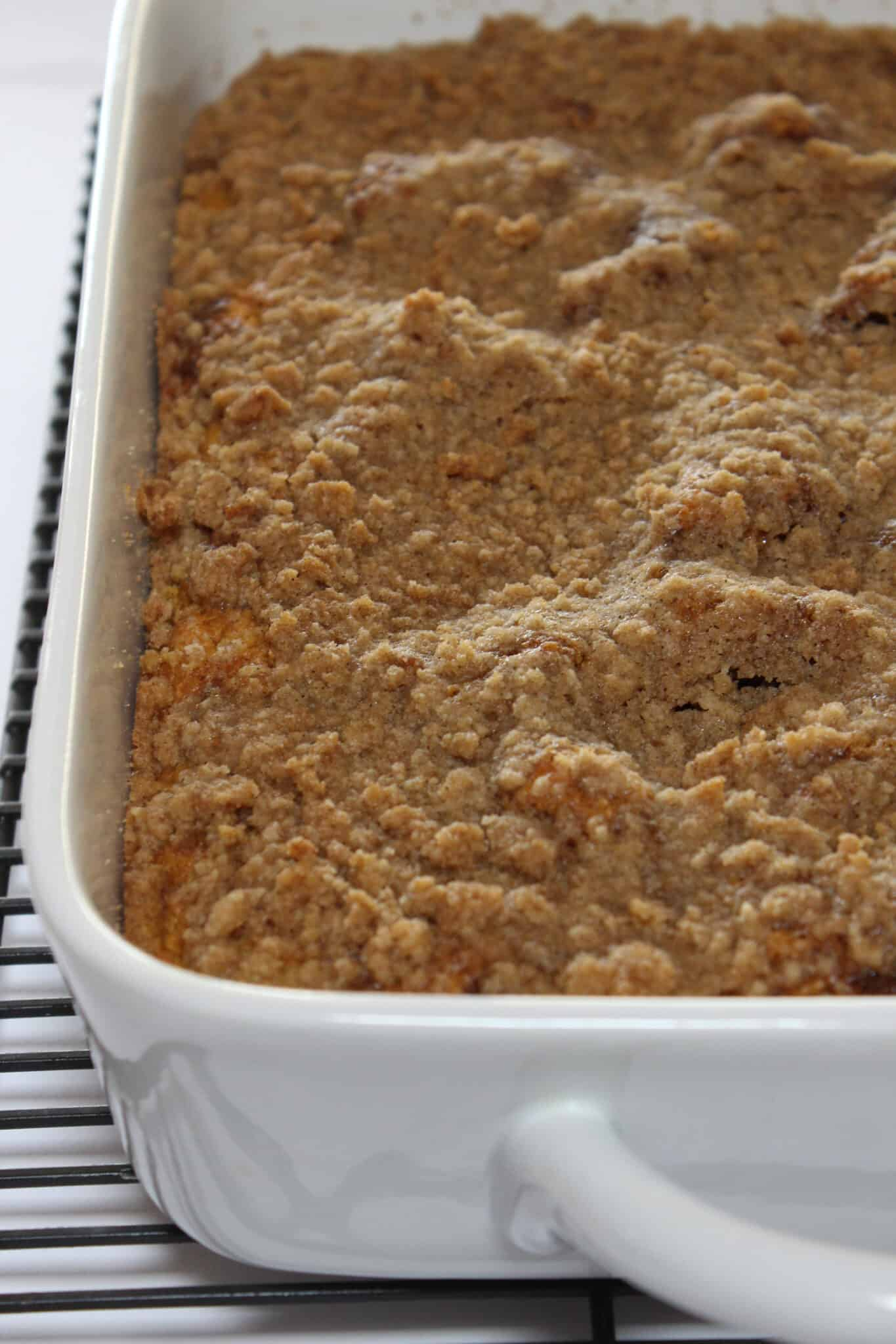 Pumpkin Cinnamon Roll Crumb Cake recipe featured by top US food blog, Practically Homemade
