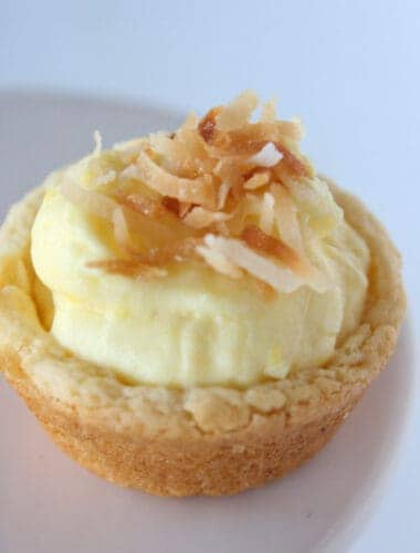 Coconut Cream Pie Cookie Cups Recipe featured by top US cookie blog, Practically Homemade