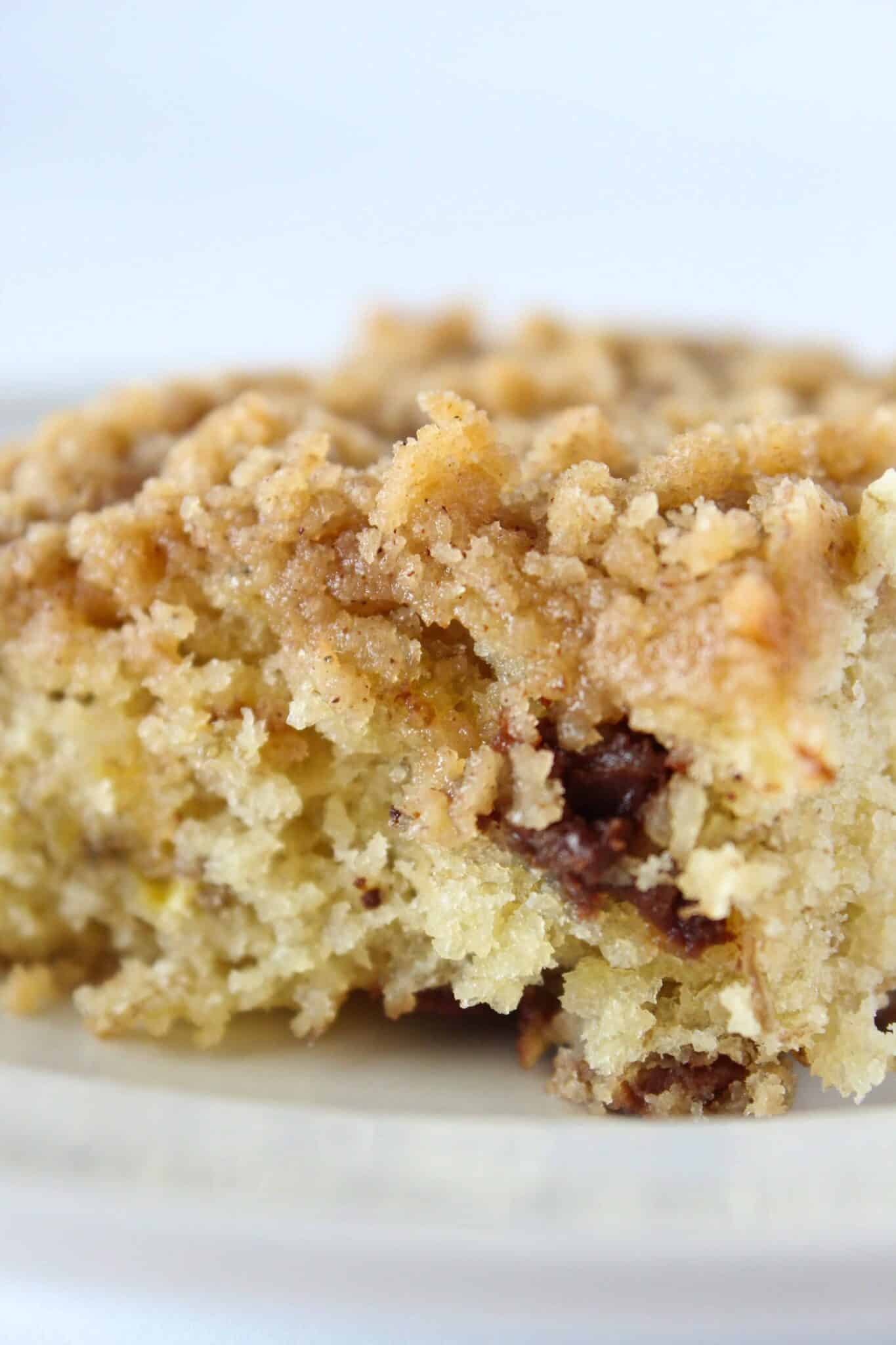 Banana Chocolate Chip Crumb Cake Recipe featured by top US desert blog, Practically Homemade