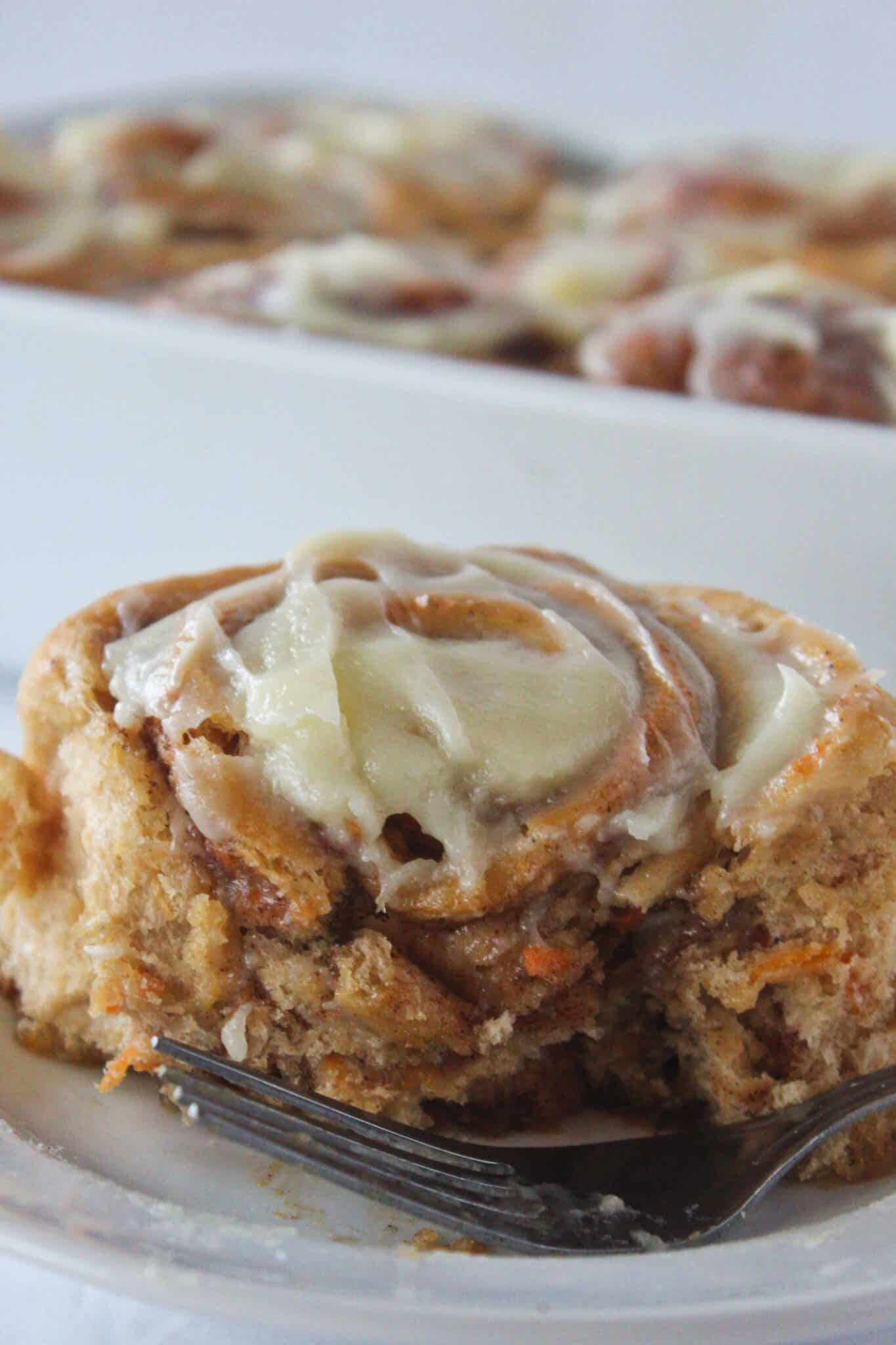 Easy Carrot Cake Mix Cinnamon Rolls with Cream Cheese Frosting Recipe featured by top US dessert blog, Practically Homemade.