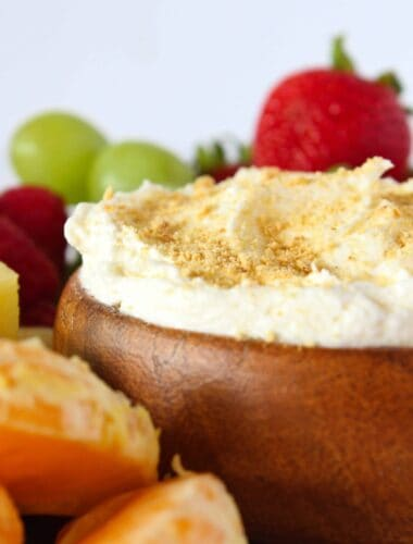 Quick Summer Desserts: Easy Cheesecake Fruit Dip Recipe featured by top US dessert blog, Practically Homemade.