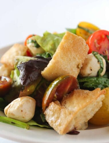 Quick Summer Salads: Easy Bruschetta Salad Recipe featured by top US food blogger, Practically Homemade