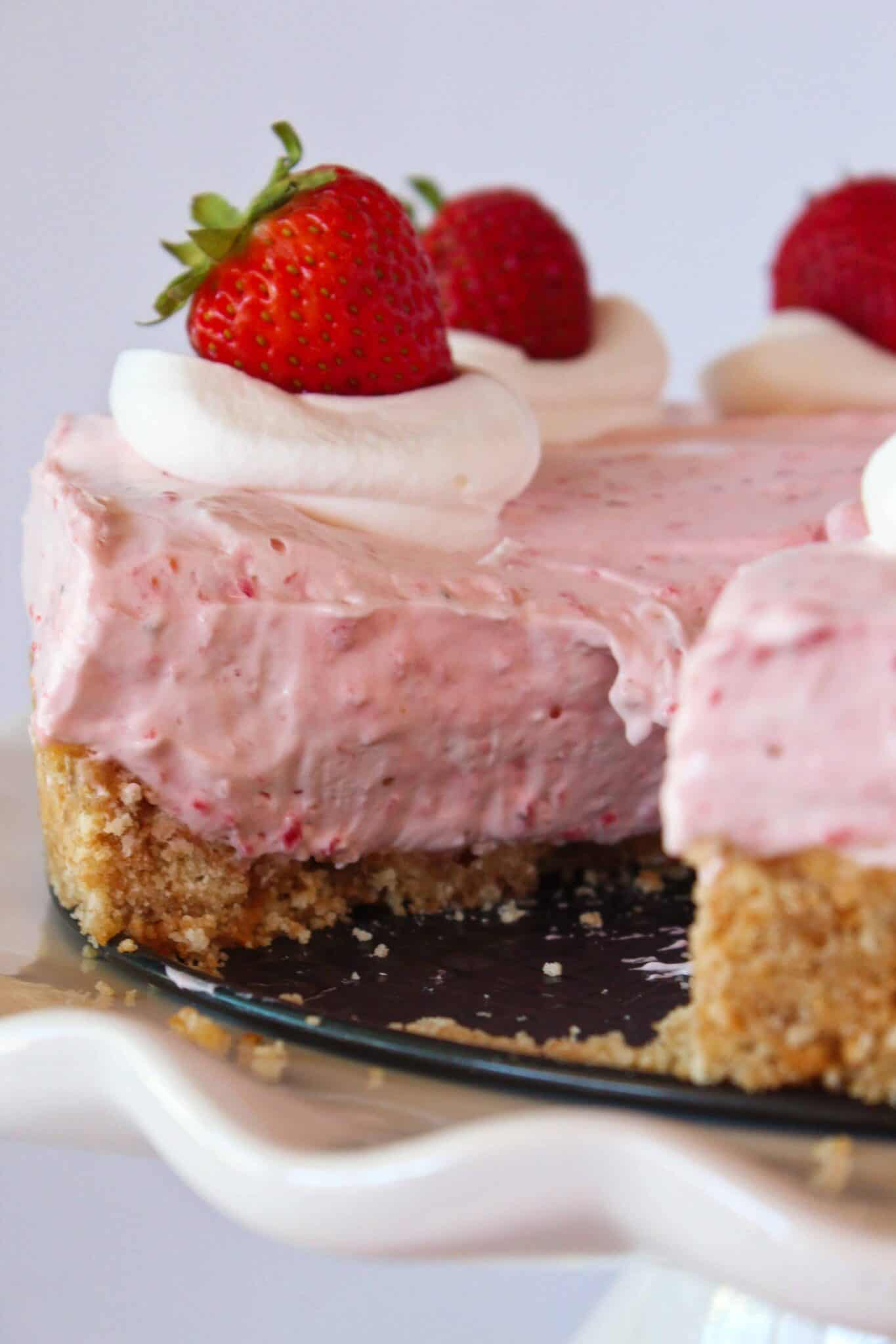Easy No Bake Strawberry Cheesecake featured by top US dessert blogger, Practically Homemade