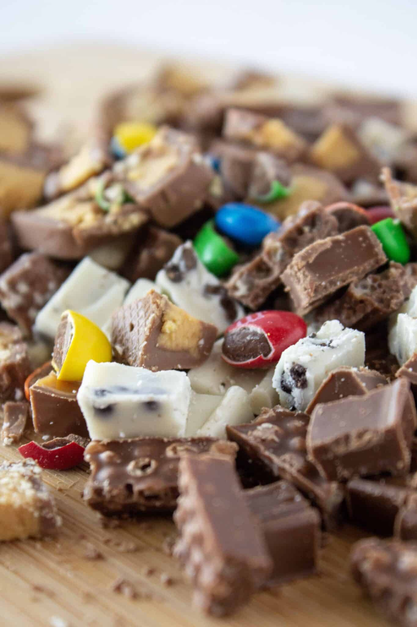 No Bake Halloween Candy Cheesecake Recipe featured by top US dessert blogger, Practically Homemade