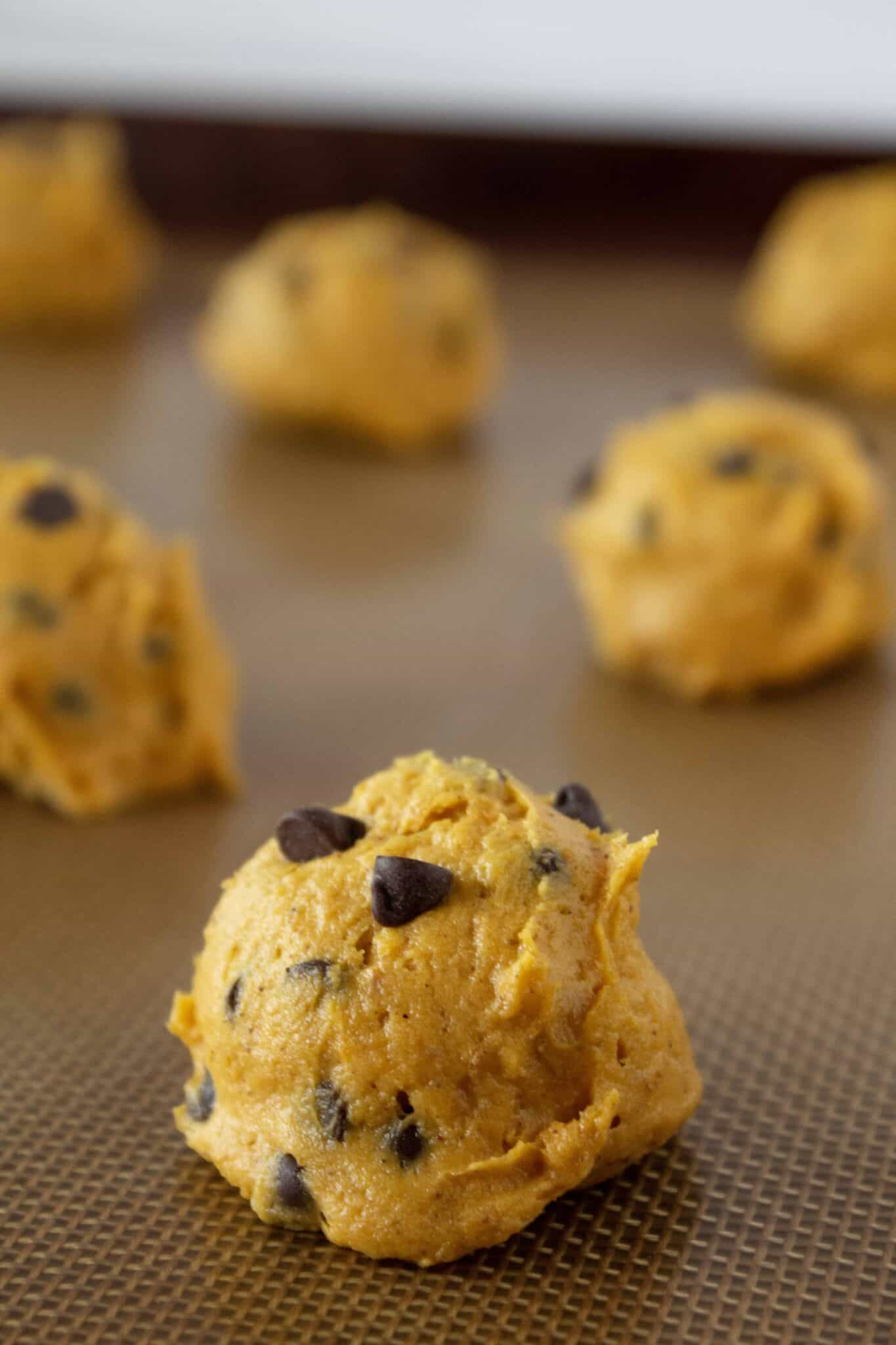Pumpkin Chocolate Chip Cookies recipe with a Cake Mix featured by top US cookies blogger, Practically Homemade
