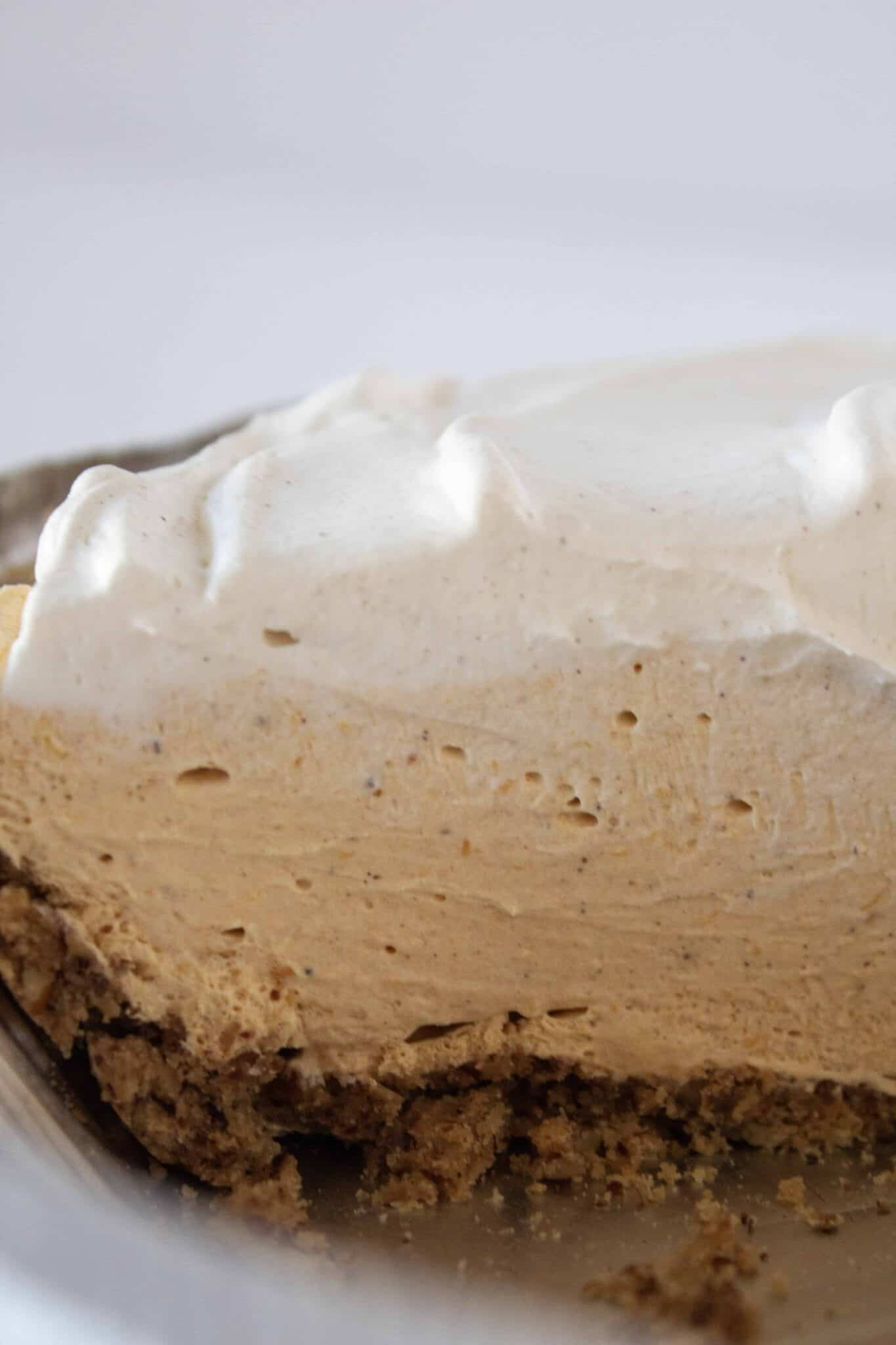 Fall Desserts: Easy No Bake Pumpkin Mousse Pie Recipe featured by top US dessert blogger, Practically Homemade