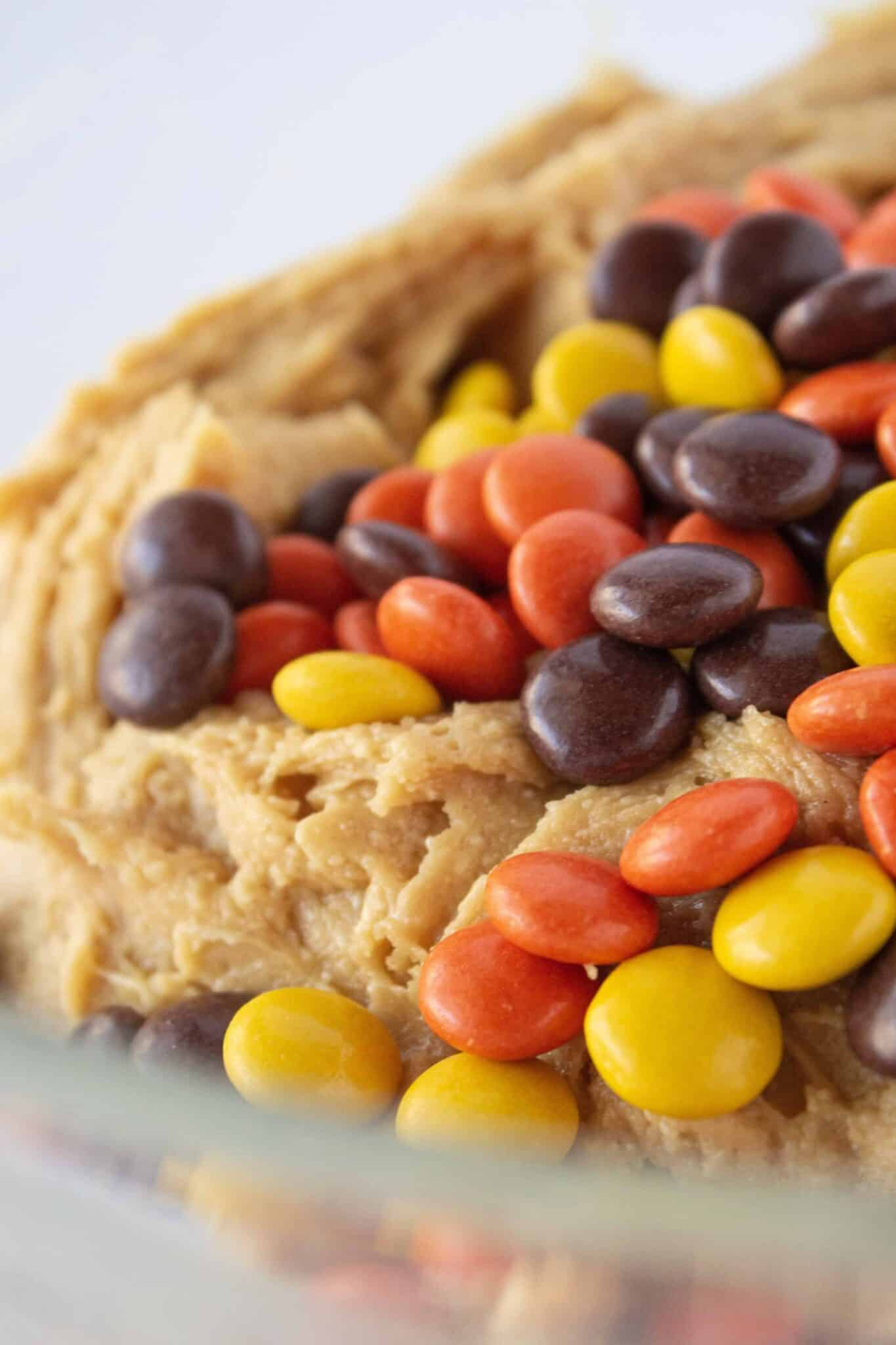 Reese's Pieces Peanut Butter Cookies Recipe with a Cake Mix and Dipped in Chocolate featured by top US cookies blogger, Practically Homemade