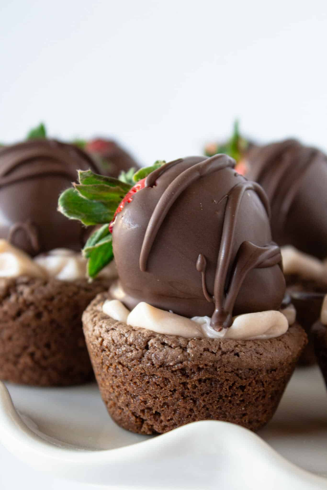 Chocolate Covered Strawberry Cookie Cups Recipe featured by top US cookie blogger, Practically Homemade