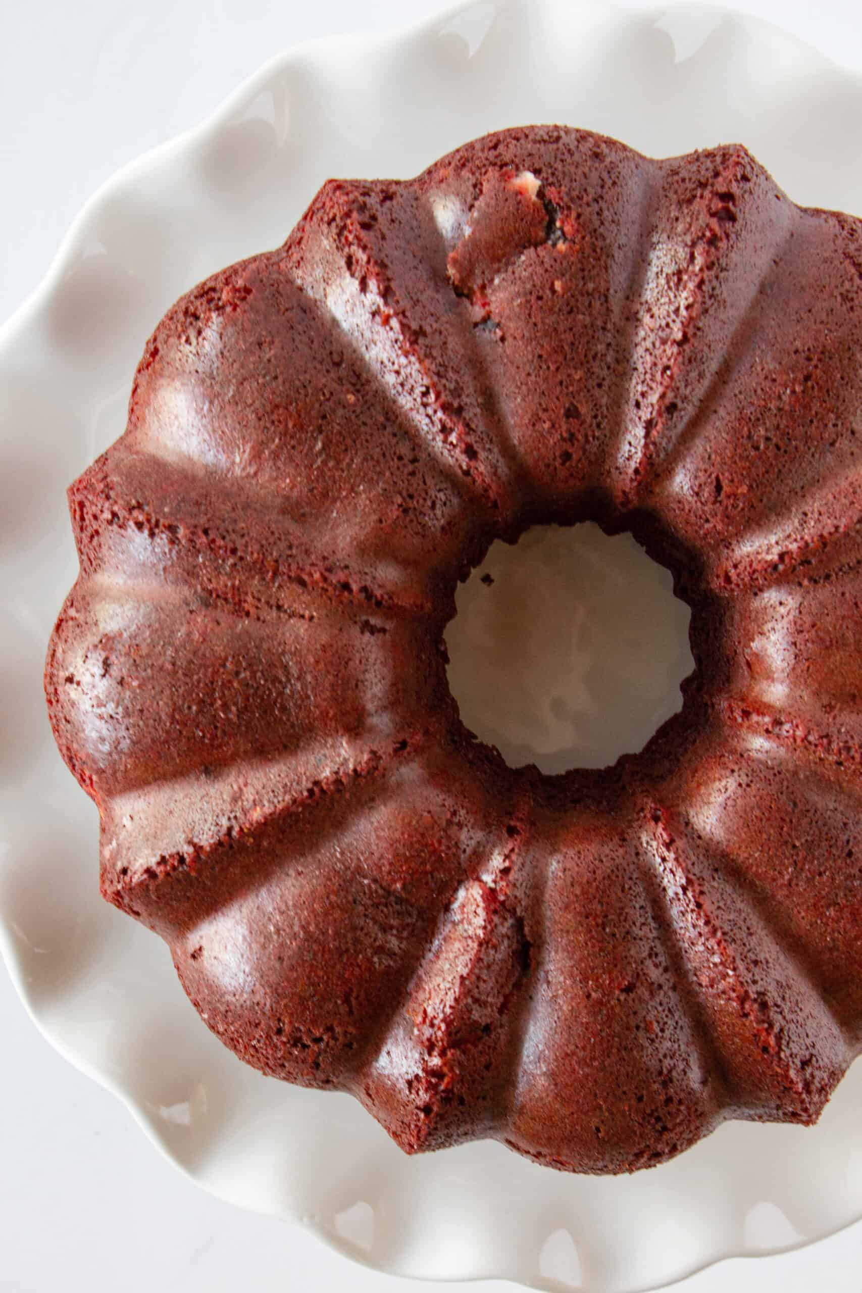 Red Velvet Bundt Cake Recipe with Cake Mix featured by top US dessert blogger, Practically Homemade