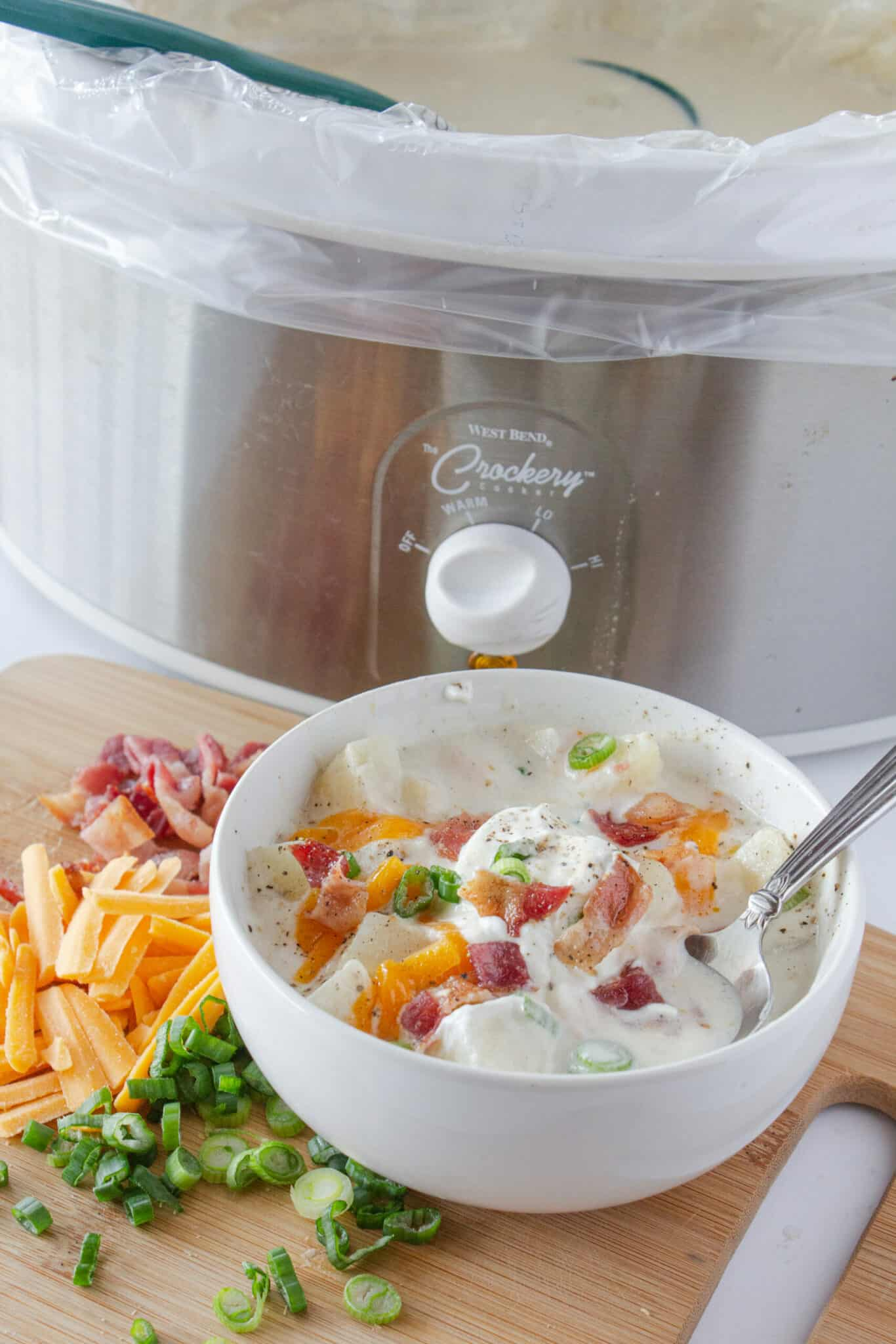 Easy Crock Pot Potato Soup with Cream Cheese Recipe featured by top US food blogger, Practically Homemade