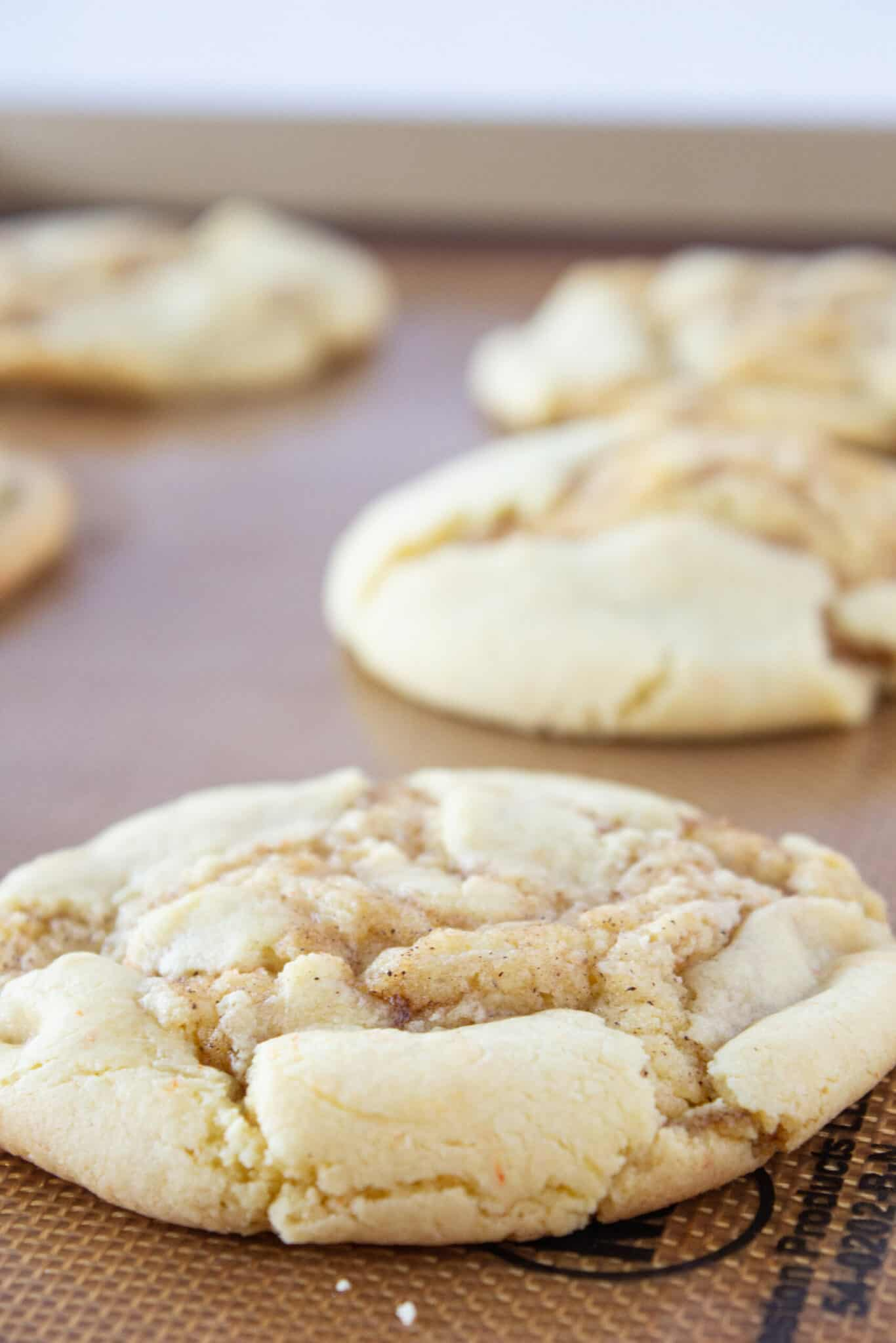 Easy Cinnamon Roll Cookies Recipe made with a cake mix featured by top US cookies blogger, Practically Homemade