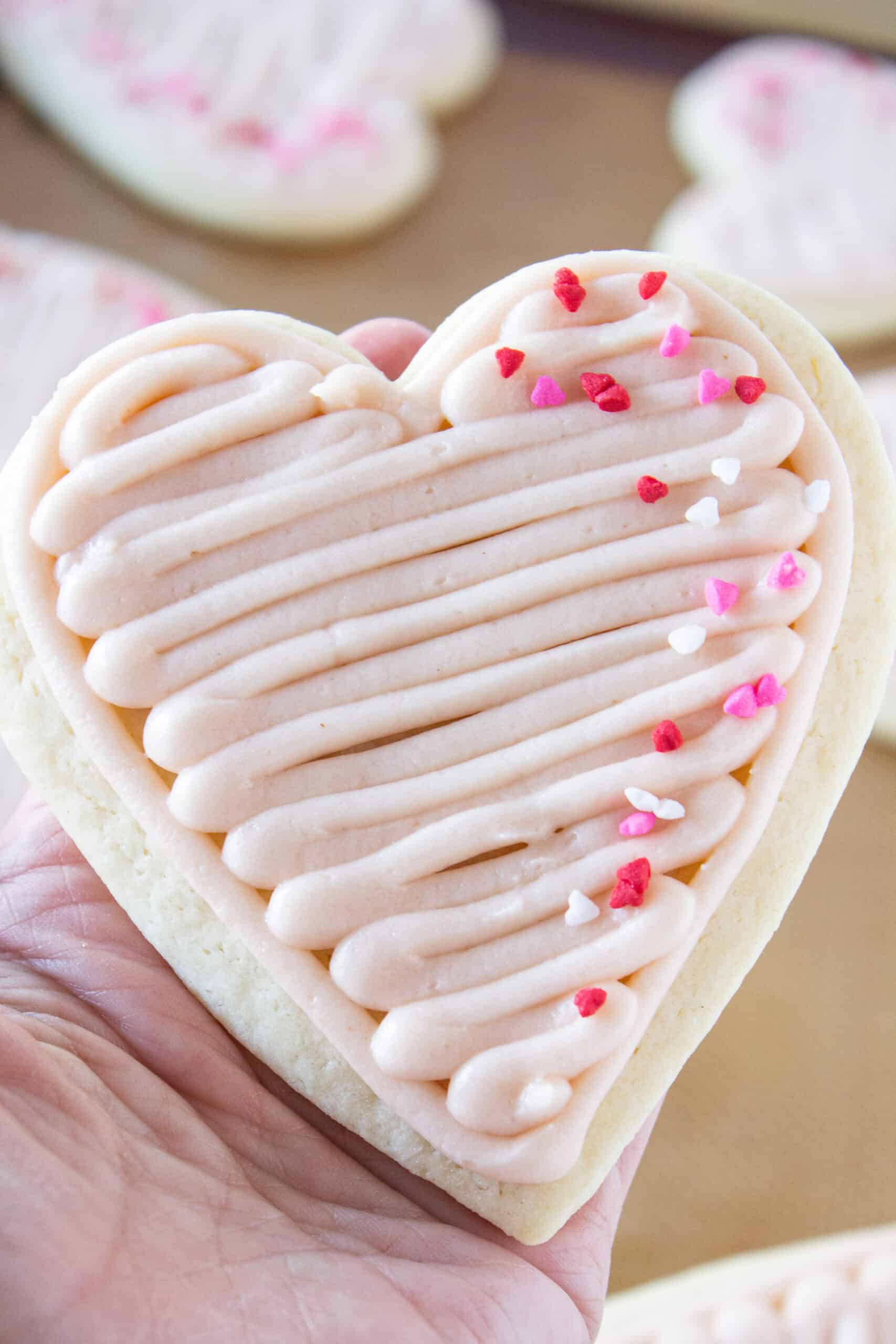 Easy Valentine Heart Shaped Sugar Cookies Recipe with Easy Strawberry Buttercream Frosting featured by top US cookie blogger, Practically Homemade