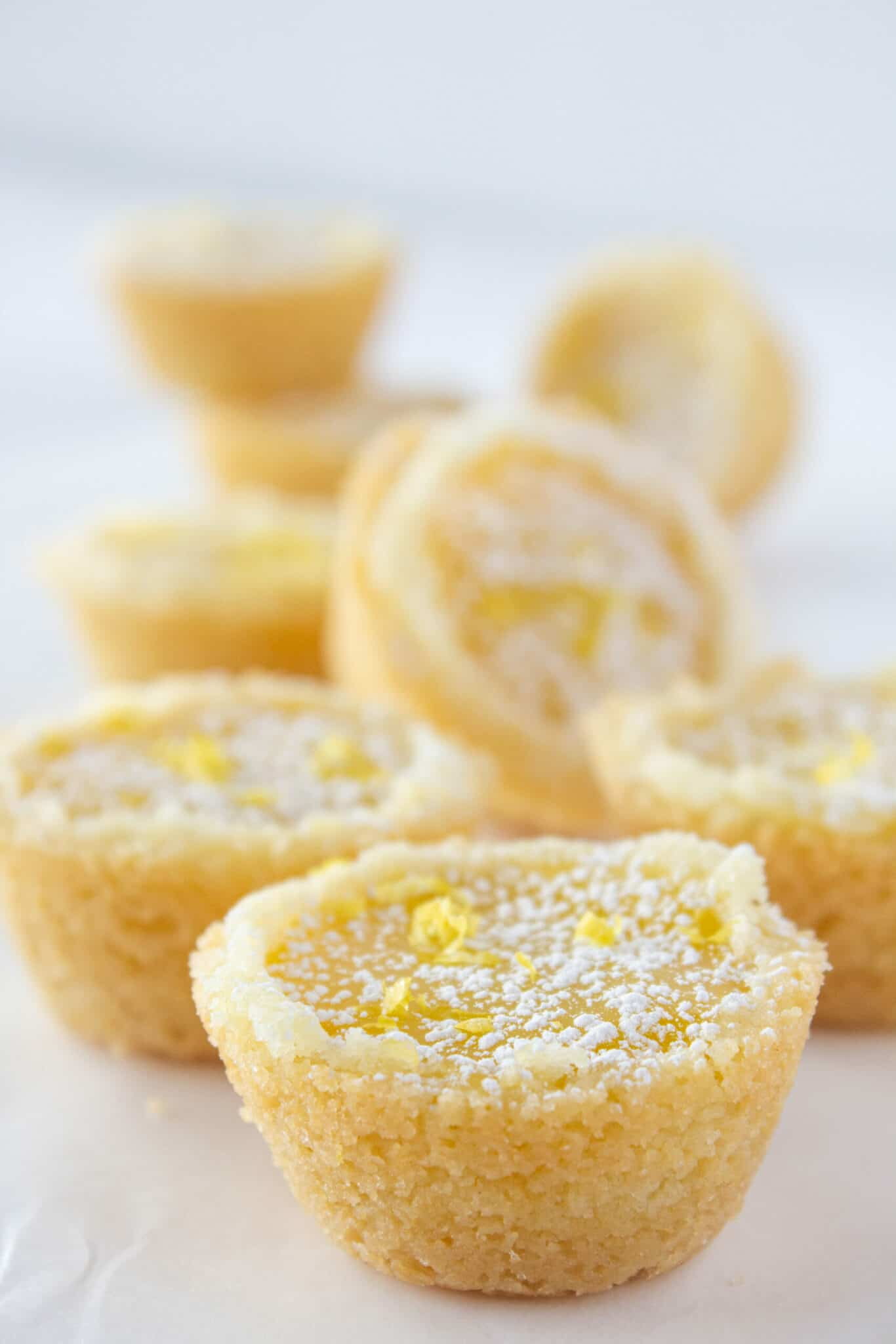 Lemon Bar Cookie Cups Recipe with the Best Sugar Cookie Mix featured by top US cookie blogger, Practically Homemade