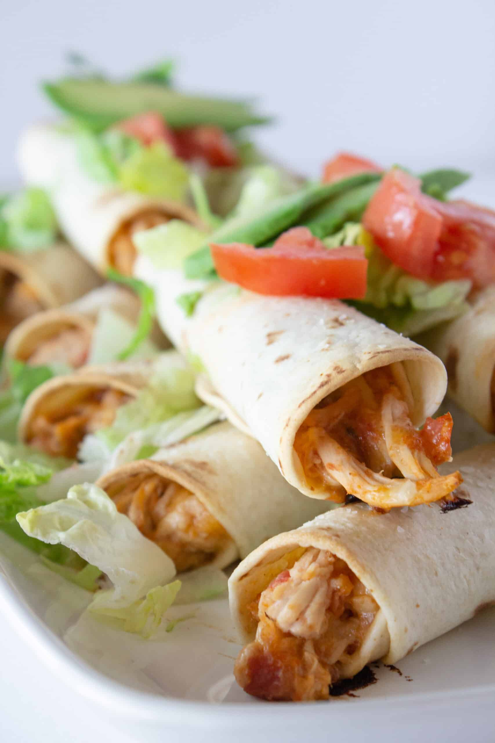 Dinner Ideas: Easy 5 Ingredient Chicken Taquitos, a Recipe featured by top US food blogger, Practically Homemade