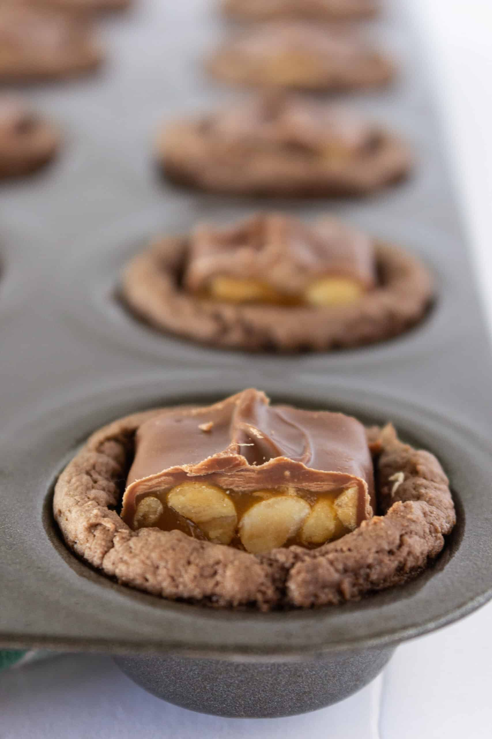 Easy Snickers Cookie Cups Recipe featured by top US cookie blogger, Practically Homemade