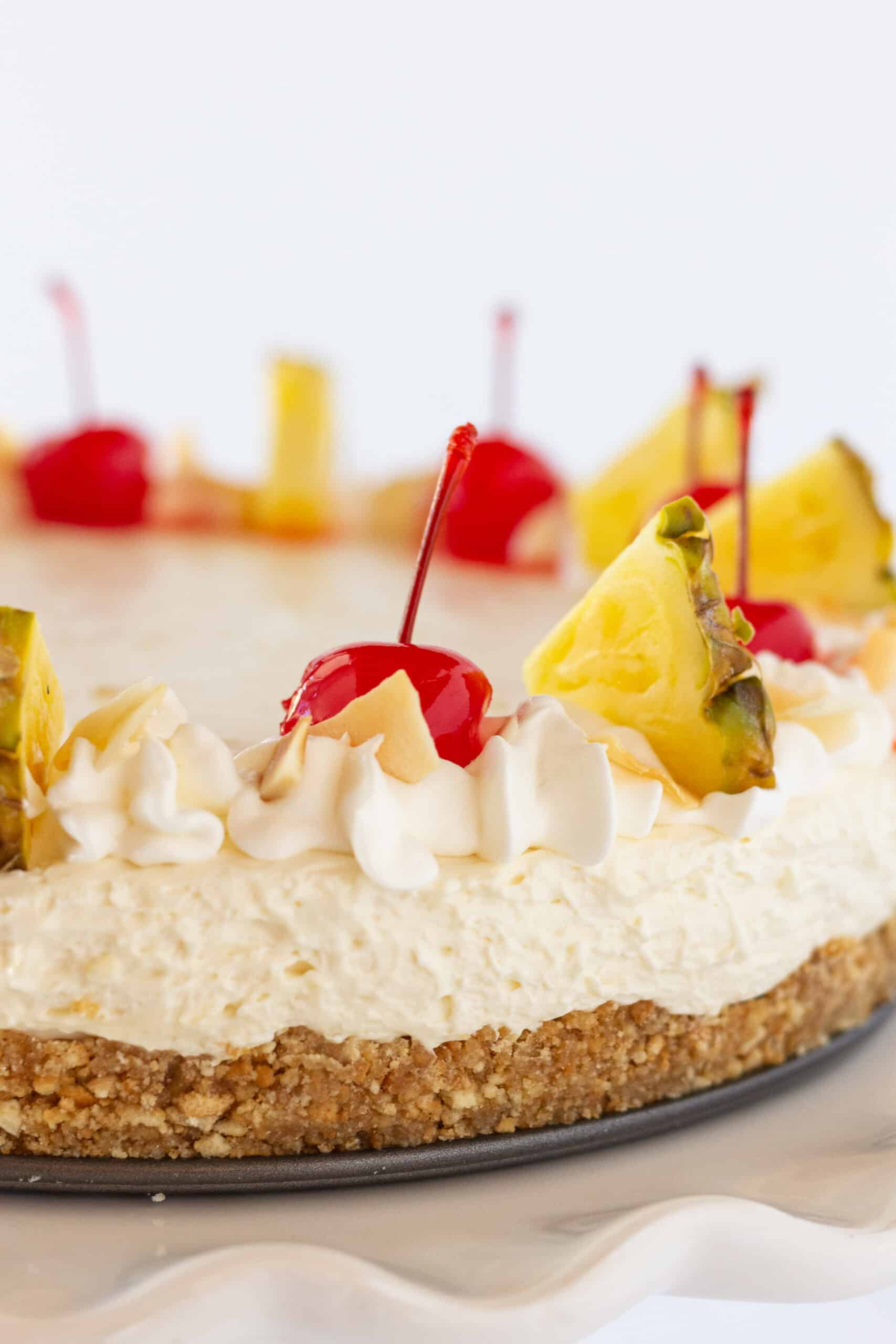 Easy Cheesecakes: Festive Pina Colada Cheesecake Recipe featured by top US dessert blogger, Practically Homemade