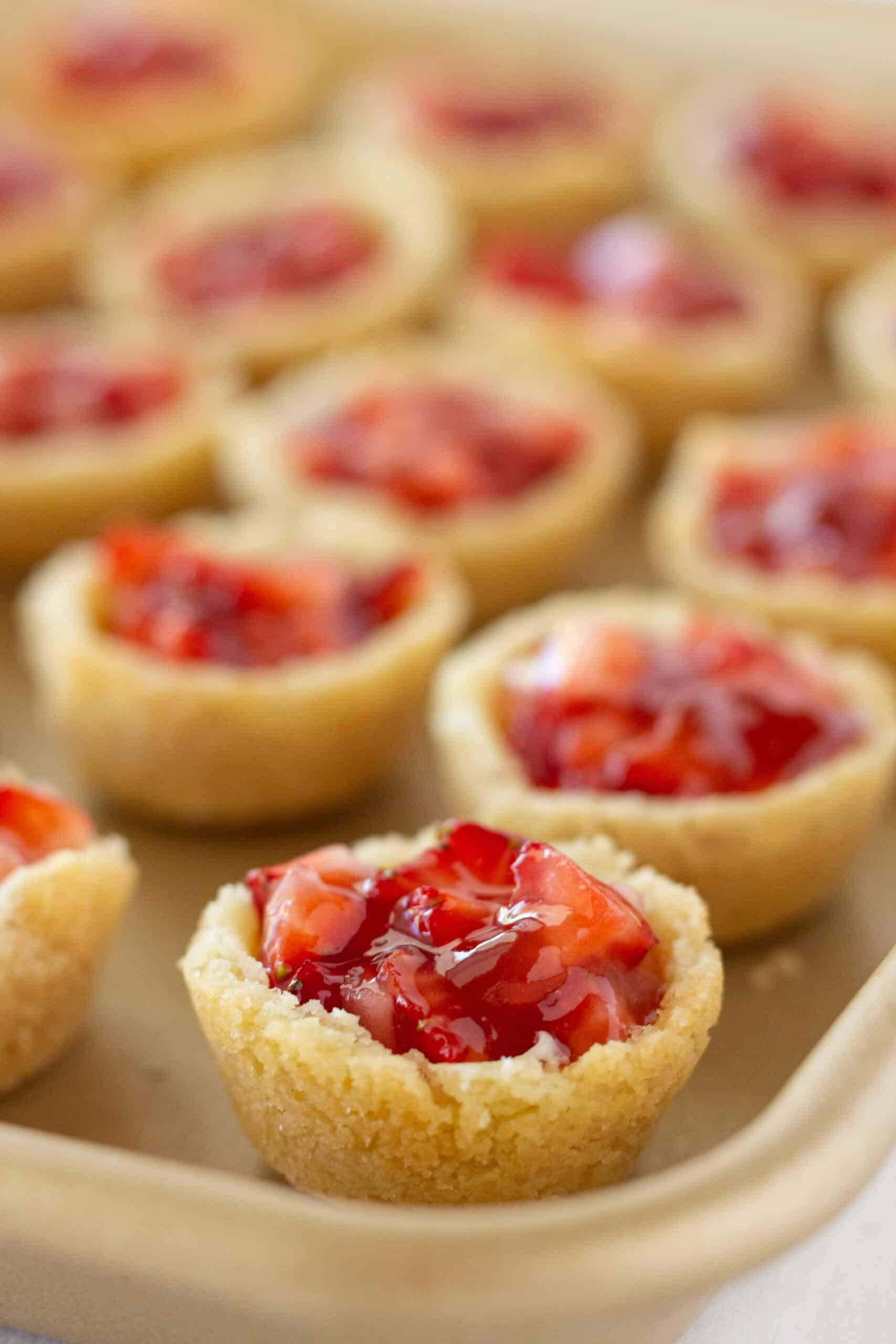 Strawberry Cream Cheese Pastry Bites Recipe featured by top US dessert blogger, Practically Homemade