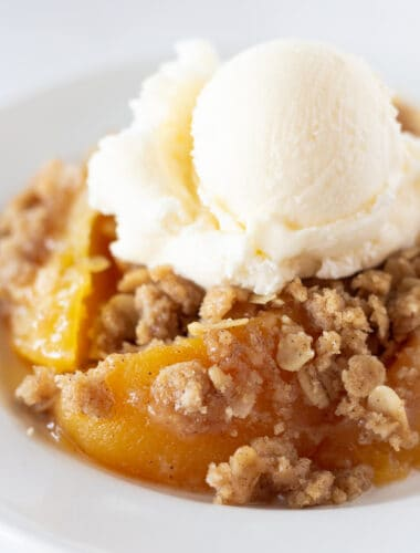 Easy Peach Crisp Recipe with Canned Peaches featured by top US dessert blogger, Practically Homemade