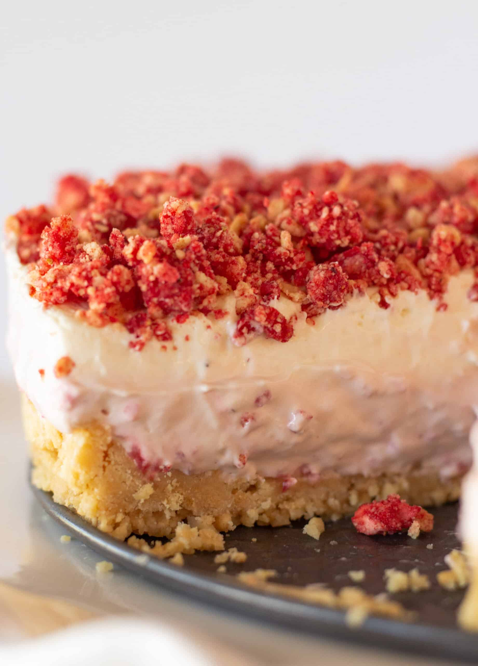 Strawberry Crunch Cheesecake recipe with a Golden Oreo Crust featured by top US dessert blogger, Practically Homemade