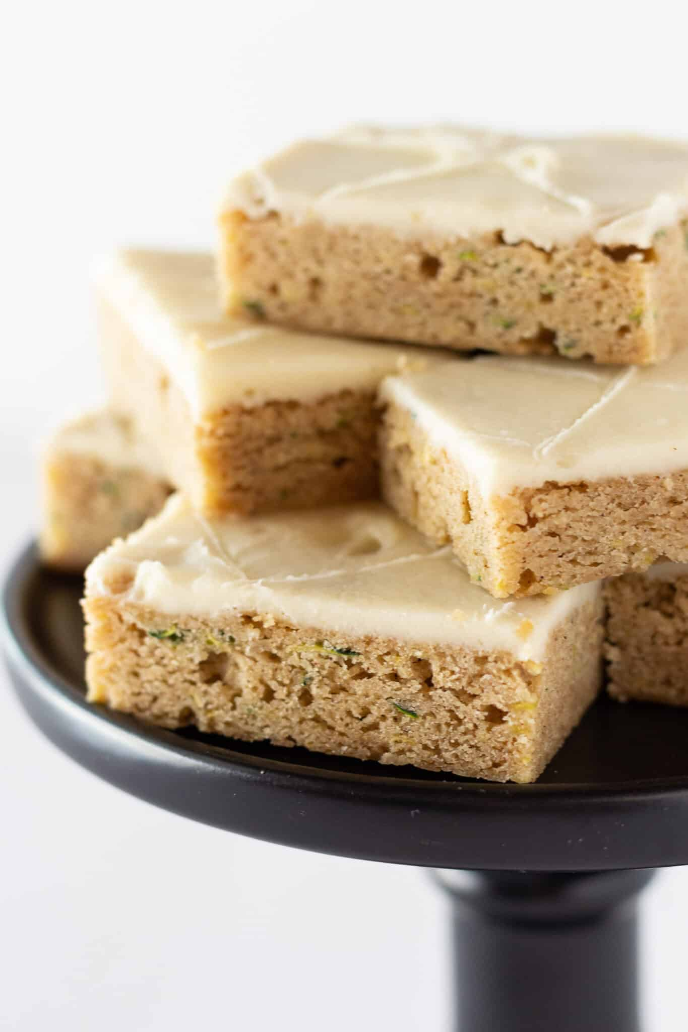 Zucchini Bars Recipe with Cream Cheese Frosting featured by top US dessert blogger, Practically Homemade