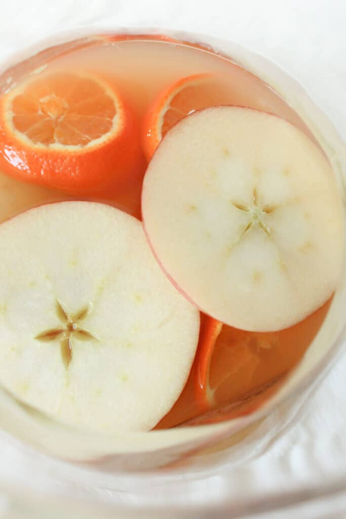 Cider Sangria Spritzer Recipe, a Fall Cocktail featured by top US recipe blogger, Practically Homemade