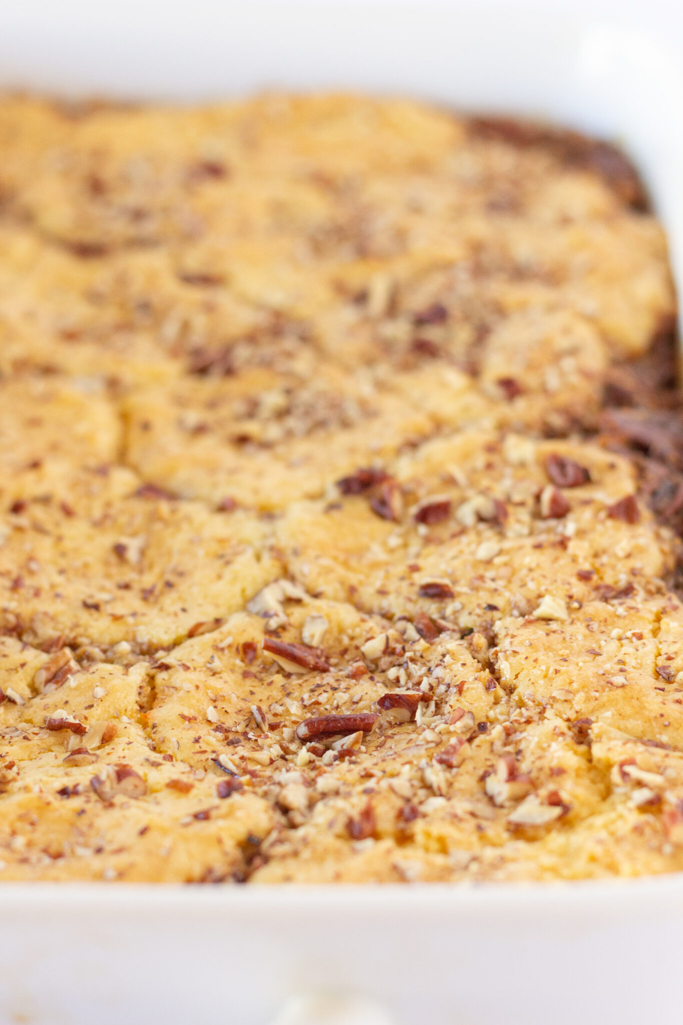 Easy Pecan Pie Cobbler Recipe with a Cake Mix, a fall dessert featured by top US dessert blogger, Practically Homemade.